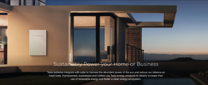 a photo of a house with Tesla Powerwall 2, in relation to Tesla rooftop solar shingles