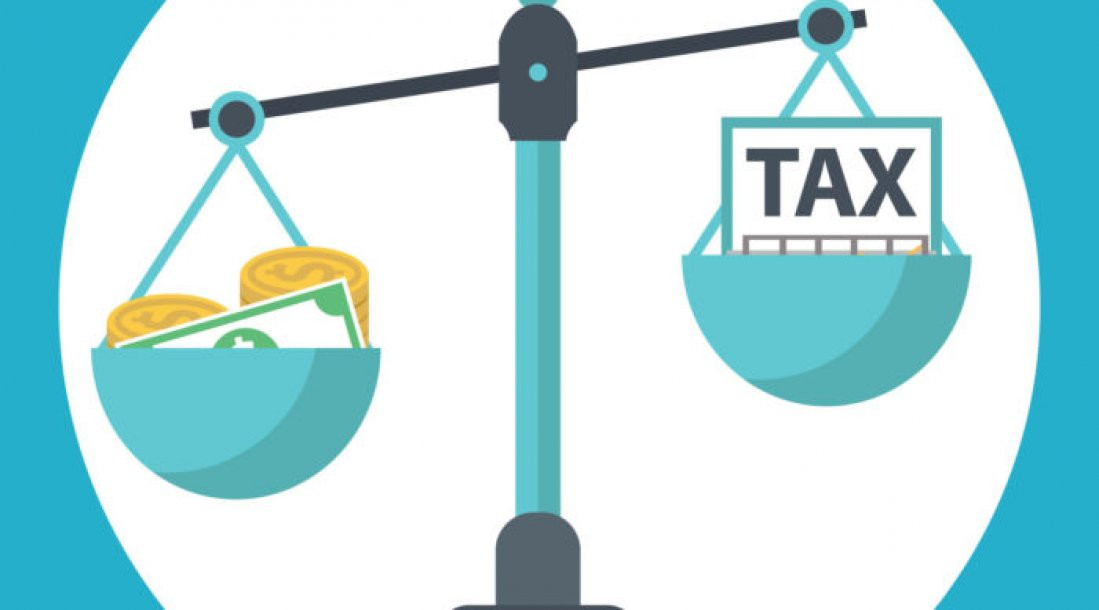 a photo of a weighing scale with one arm lowered by money and the other, being lifted as though lighter, are people's taxes—all symbolizing the ongoing discussion on the impact of taxation on economic development