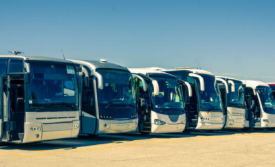 parking lot full of eco-friendly public transportation buses