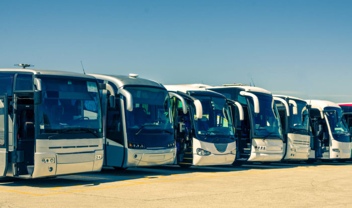 parking lot full of eco-friendly public transportation buses