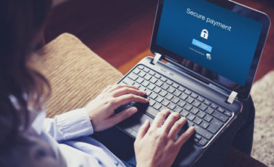 image of a secure payment login on a woman's laptop