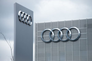 photograph of Audi logo on the outside of grey building