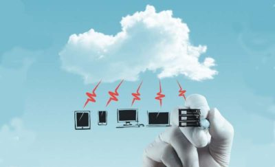 Picture of digital devices and the cloud.