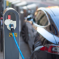 photograph of an electric car charging its battery