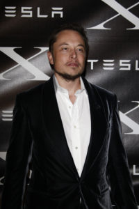 Elon Musk poses for a Tesla event