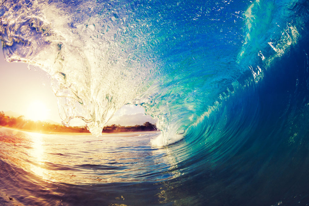 Wave with the sun coming up