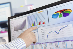 finger pointing to web analytics on a screen
