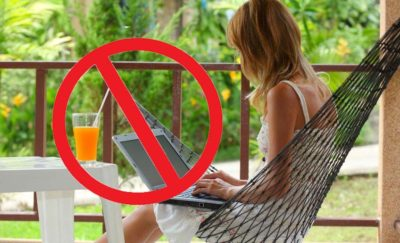 Woman on her porch with a laptop and No sign superimposed - ibm work from home policy got reversed