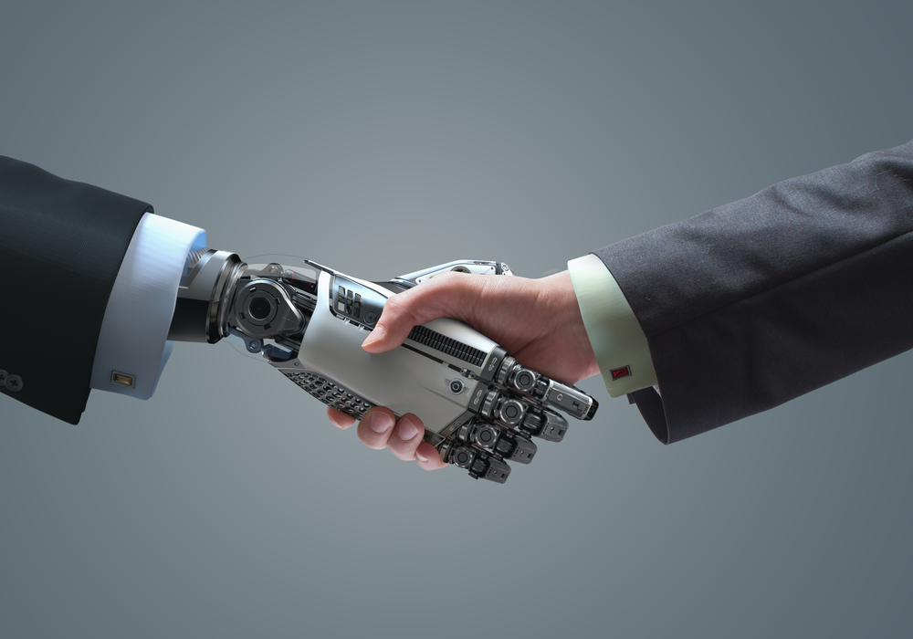 a robot hand and a human hand in a handshake amid the possible reality of a robot CEO in the future