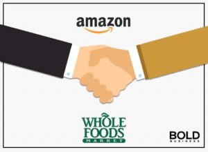Shaking hands representing amazon and whole foods deal.