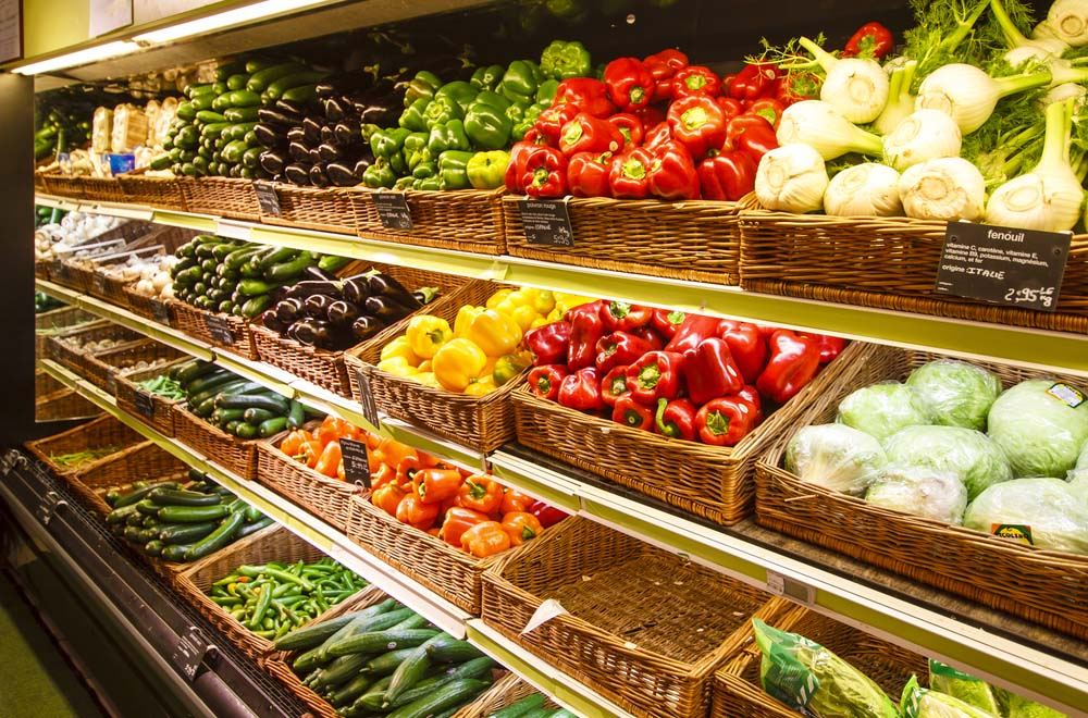 a photo of shelves of fresh produce in a grocery store amid Amazon Acquisition of Whole Foods