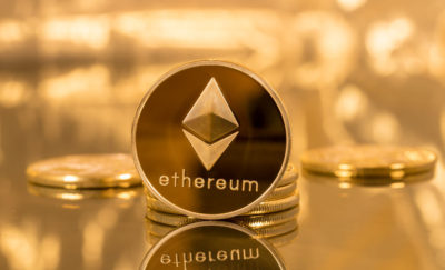 A picture of a coin with the Ethereum logo.