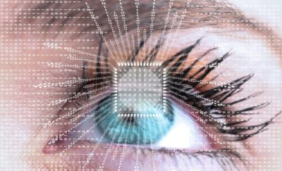 Futuristic eye with data and computer chip