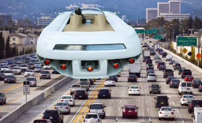 A car flying over a traffic jam in Los Angeles.