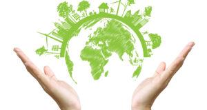 hands holding a green world.
