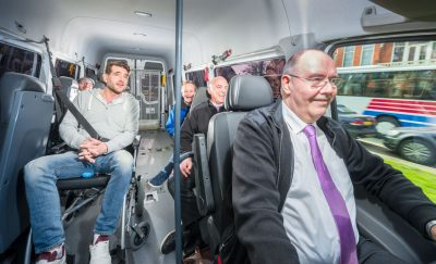 Man in wheelchair in van. Public and Private Partnership for Infrastructure Development