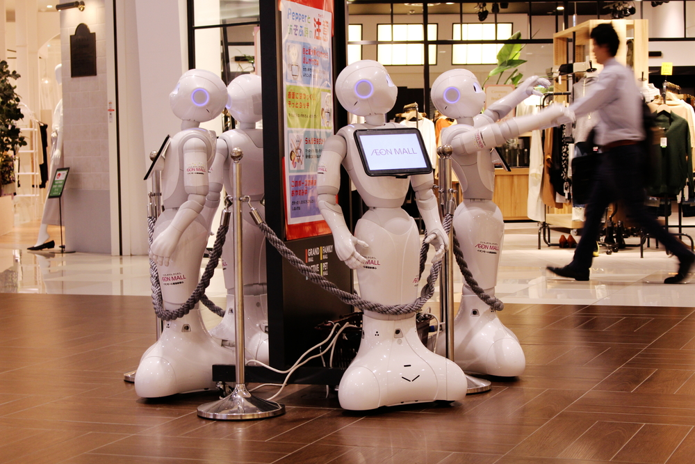 a photo of a group of Pepper Robots on display in an Asian Mall amid the existence of SoftBank CEO Masayoshi Son
