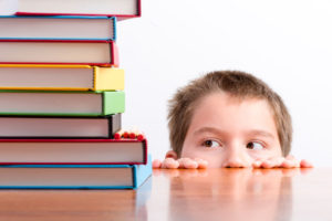 an image of a child looking at books amid the rise of EdTech companies