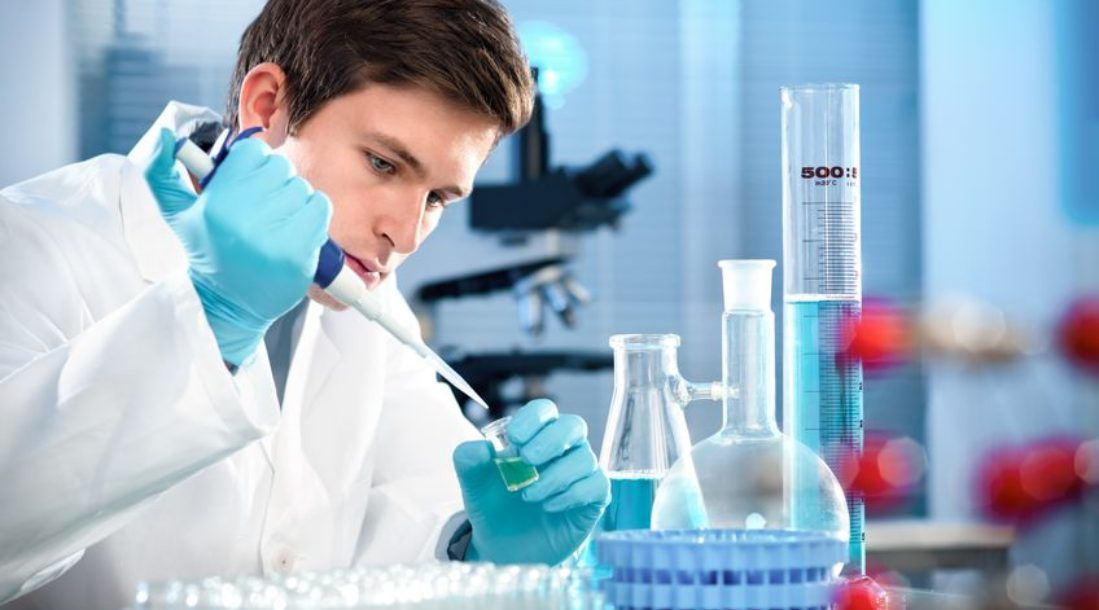 a photo of a researcher in laboratory doing his undergraduate research