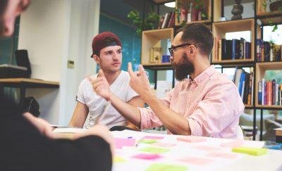 a photo of collegiate entrepreneurs discussing business