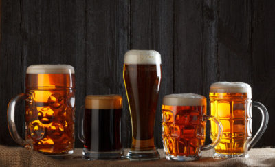 a photograph of different beers in various glass mugs