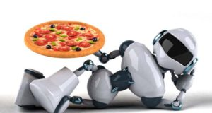 A robot holds a pizza.