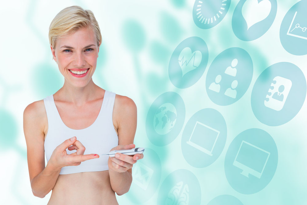roche acquires mysugr, image of woman testing blood sugar for diabetes