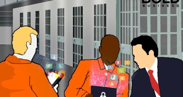 Prisoners with tablets prefilled with education materials