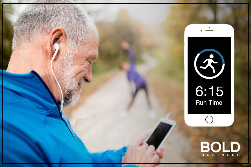 a photo of a male senior citizen with his smartphone while pausing from his trail run, in relation to discussions about healthcare for senior citizens