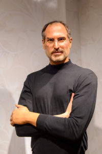 a photo of Steve Jobs in Beijing while wearing black turtleneck shirt amid his own journey of failure to success