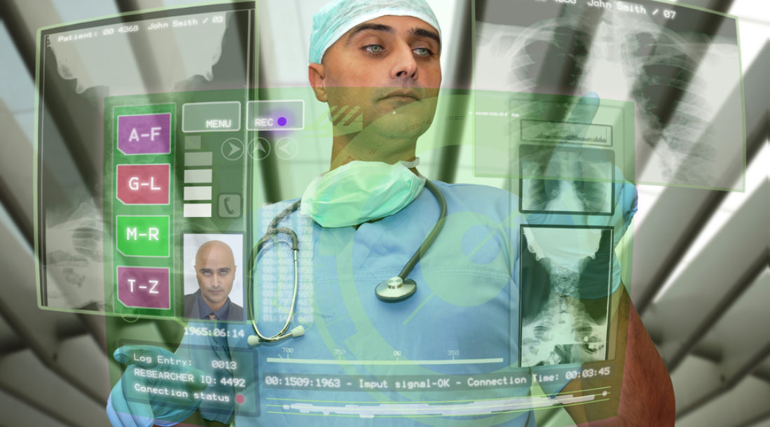 a photo of a doctor in a surgeon's suit manipulating a hologram screen of technological applications for the medical field amid the recently announced matter of the health innovation funding UK