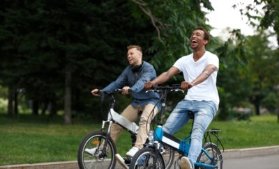 Two men on electric powered bicycles