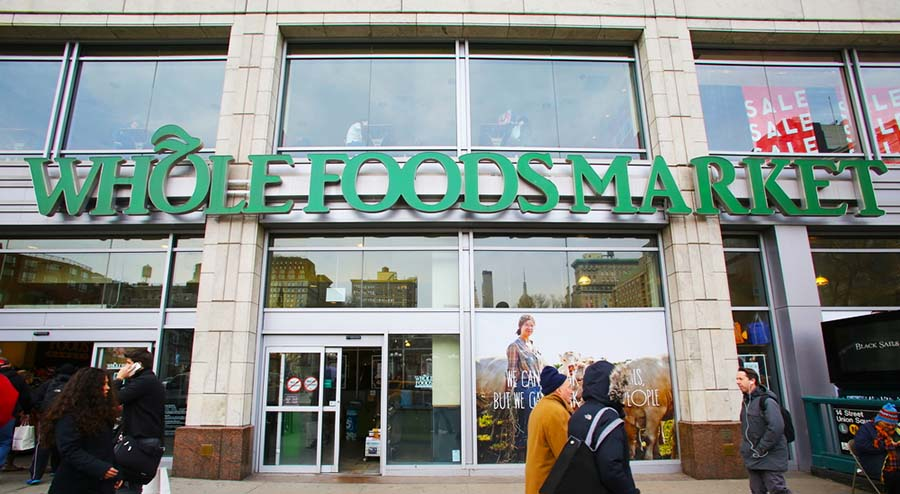 a photo of a Whole Foods storefront in New York City in relation to Whole Foods potentially utilizing the Amazon cashierless store technology