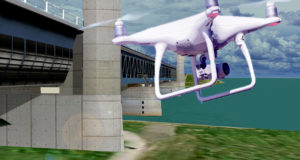 A drone flies towards a bridge