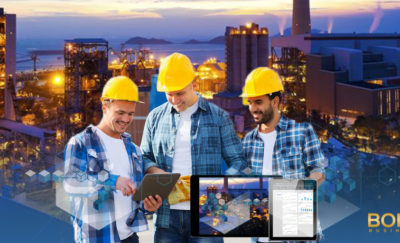 Men in hardhats consulting digital data
