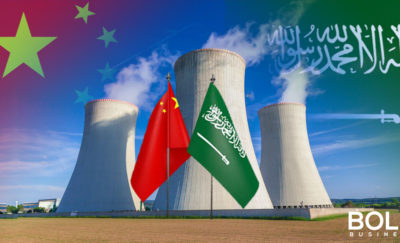 Saudi Arabia and Chinese flags in front of a nuclear reactor