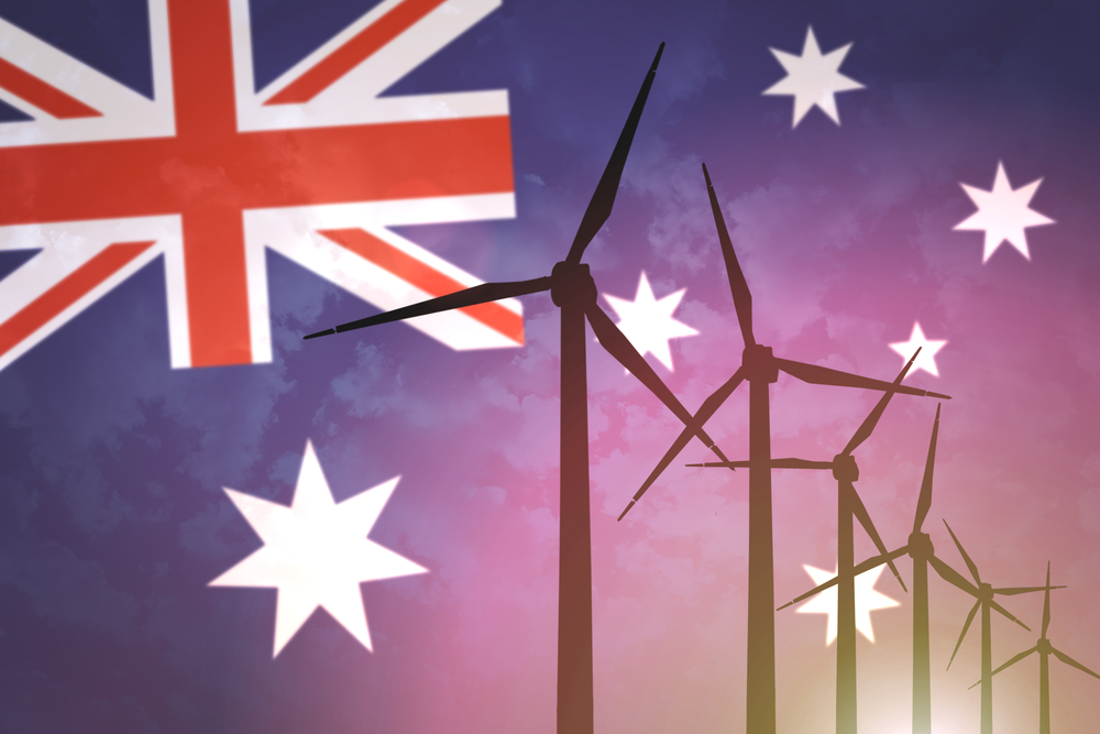 a photo of wind turbines on a background of the Australian flag in anticipation of the rise of GE wind farms in Australia