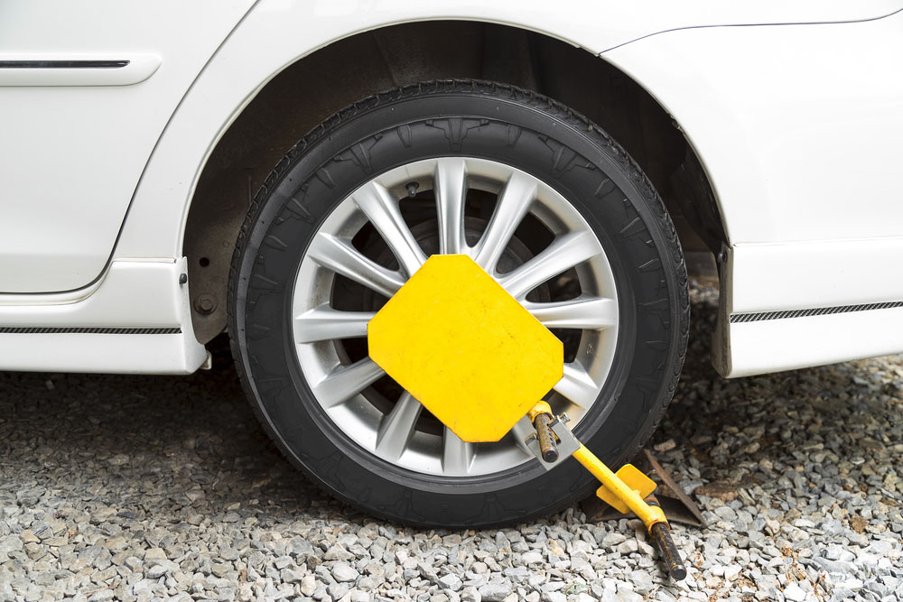 car locking tech, a smart boot way's to collect unpaid parking fees