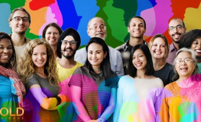 group of smiling people showing diversity and inclusion in the workplace