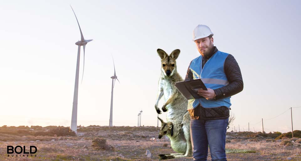 a photo of a kangaroo standing beside a power plant worker in a wind farm symbolizing the anticipated rise of GE wind farms in Australia