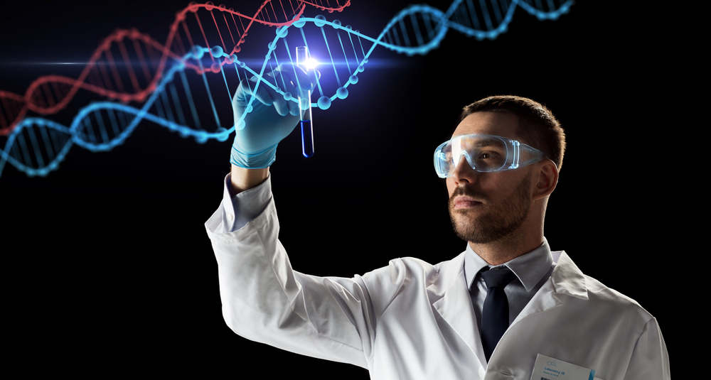 Man with test tube and DNA strands across screen.