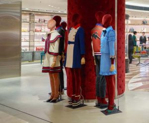 Mannequin Wears Famous Gucci's trademark stripes clothing line