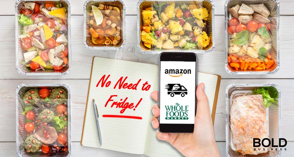 "a photo of pre-packed meals laid out on a picnic table with a notebook that has the words ""No Need to Fridge!"" written on it—and with an image of a hand holding a phone with its screen open to the logo of Amazon and Whole Foods amid Amazon's acquisition of a new Sterilization Food Preservation Technology"