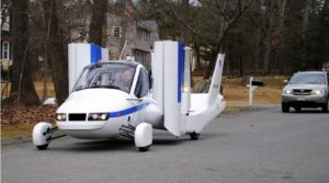 prototype flying car driving on road
