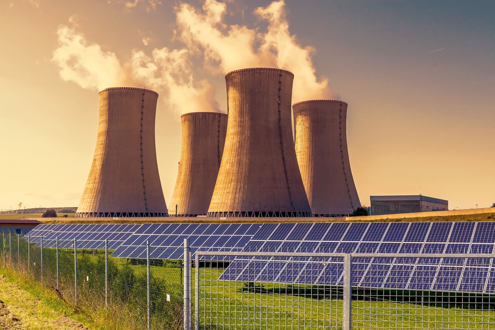 a photo of solar panels and nuclear reactors in a solar energy farm amid the question of Saudi Arabia Pursuing Nuclear Weapons or not