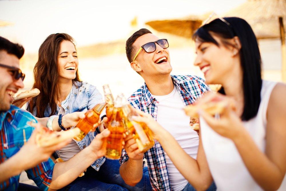 People enjoying drinks at the beach.