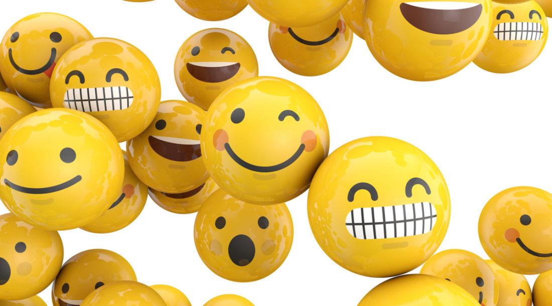 smiley face emojis on yellow balls