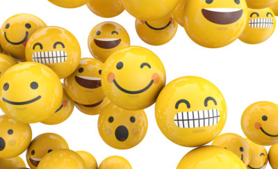 smiley face emojis on yellow balls