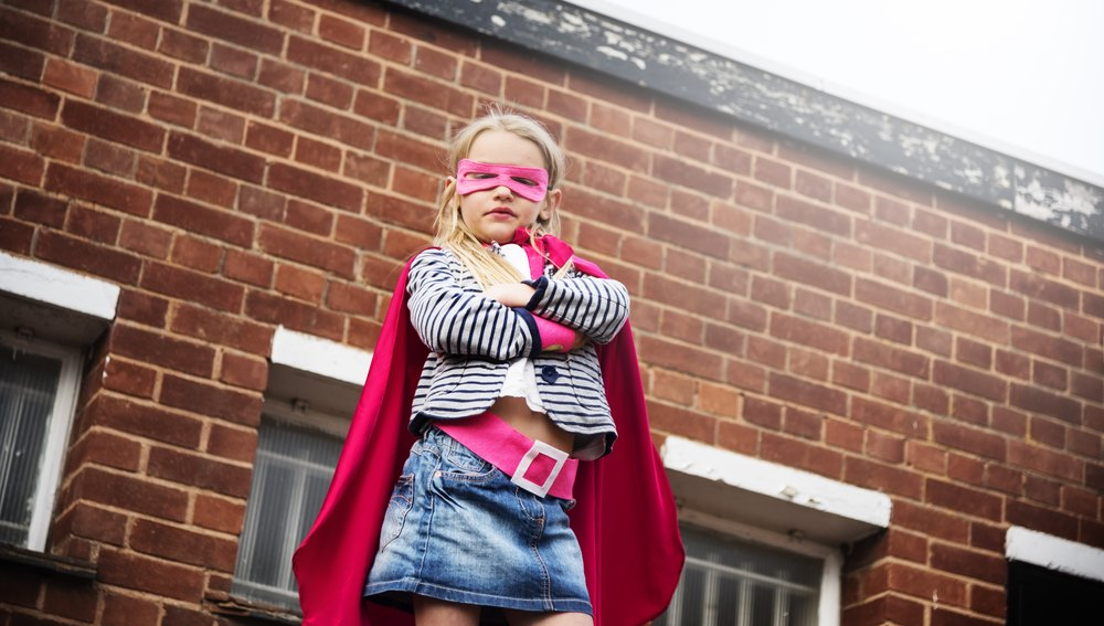 girl in superhero cape and mask