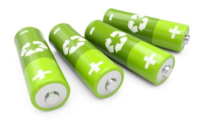 a photo of four green batteries